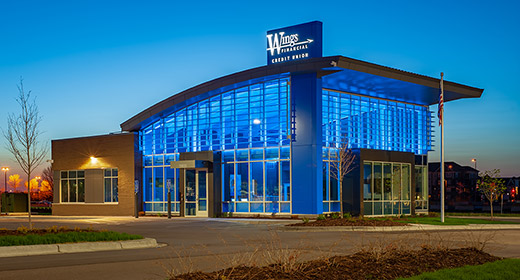 Exterior view of Maple Grove branch lit up at night